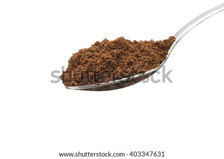 Iron spoon with coffee powder close up  - stock photo