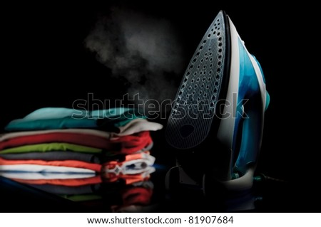 iron with clothes - stock photo