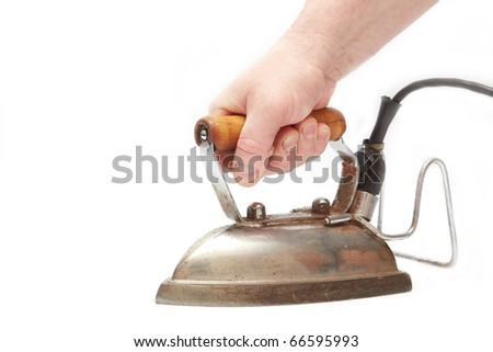 Iron with hand on white background - stock photo