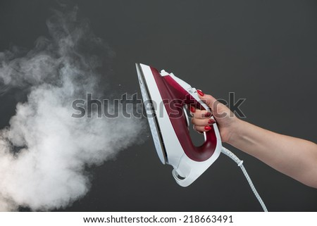 Iron with steam - stock photo