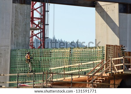 Iron worker during the early construction of the new Portland Milwaukie light rail bride over the Willamette River