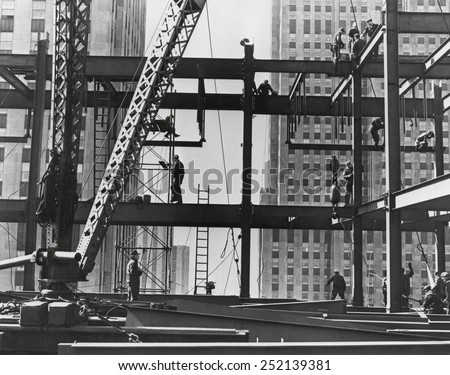 Iron workers raise steel at 32nd floor of the Esso Building in New York City. 1954. - stock photo