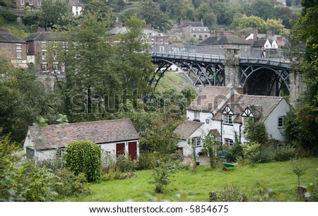 Ironbridge and cottages. - stock photo