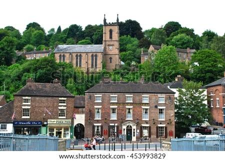 IRONBRIDGE, SHROPSHIRE, ENGLAND - JULY 10: The birthplace of the Industrial Revolution, Ironbridge is now a World Heritage site. July 10, 2016 at Ironbridge, Shropshire, England..  - stock photo