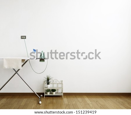 ironing board in room - stock photo