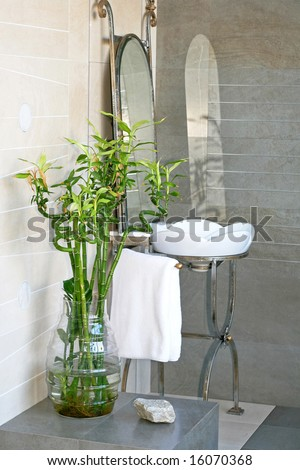 Ironwork basin in bathroom with bamboo plant