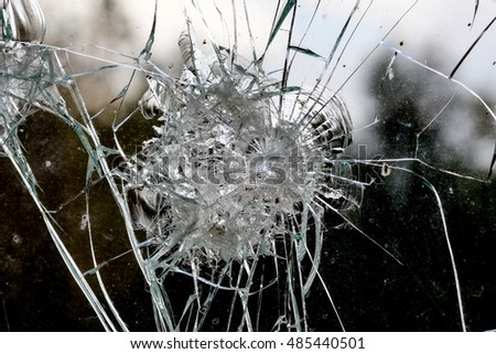 Irregular shapes of a  broken car window inside from accident