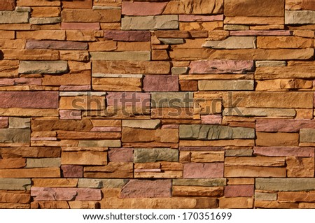 Irregular sized multicolored bricks with an organic feel. Image is seamlessly tileable - stock photo