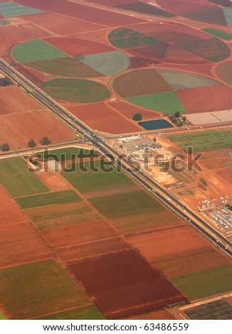 Irrigated farmland in South Africa cut through by roads - stock photo