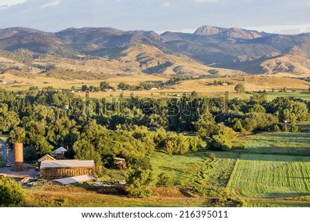 irrigated foothills farmland in sunrise light, Belvue near Fort Collins in northern Colorado - stock photo