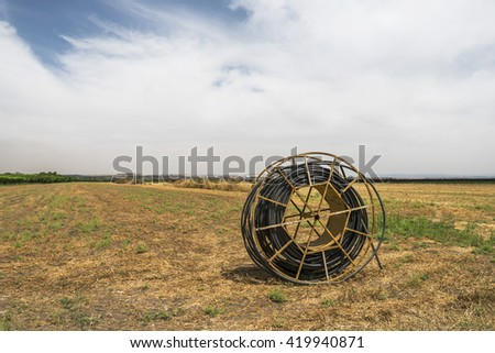Irrigation cable roll in the field