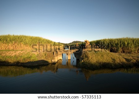 Irrigation canals in a sugar cane farm, Northern NSW, Australia - stock photo