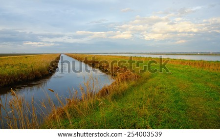 irrigation channel in countryside in summer - stock photo