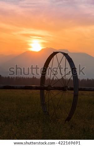 Irrigation field and sunset - stock photo