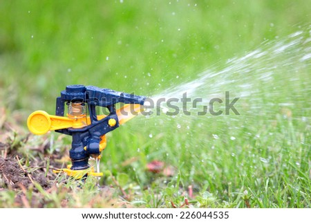 irrigation system moistening land for growing green lawn