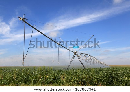 Irrigation system on a industrial farm. Irrigating soy beans. - stock photo