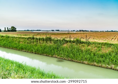 irrigation systems in modern agriculture - the modern machinery for irrigation related to ancient irrigation canals allow more effective management of water - stock photo