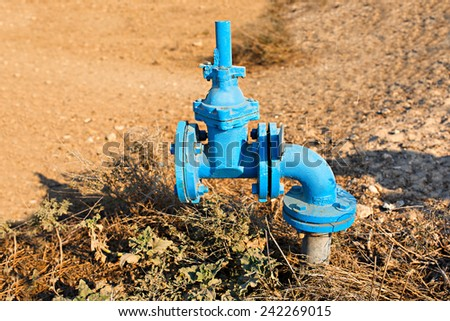 Irrigation systems, pipes and faucets for watering. - stock photo