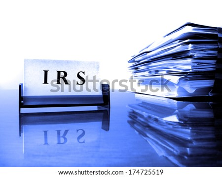 IRS Card on desck with tax files - stock photo