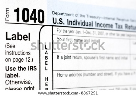 """IRS Form 1040 - Depth of Field (Focus is on the digits """"1040"""") - stock photo"""