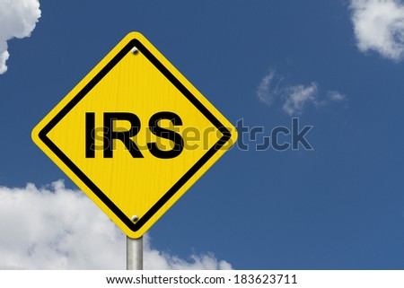 IRS Warning Sign, An American road warning sign with word IRS with a sky background - stock photo