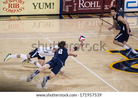 IRVINE, CA - JANUARY 17: Brigham Young's Carson Heninger dives for the dig in a volleyball match with the University of California - Irvine at the Bren Events Center in Irvine, CA on January 17, 2014 - stock photo