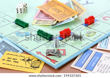 IRVINE, CA - MAY 19, 2014: Monopoly Board Game Closeup. The classic real estate trading game from Parker Brothers was first introduced to America in 1935. - stock photo