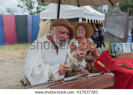 Irwindale, CA - USA - May 07, 2016: Musician playing medieval instruments during The 54th Annual Renaissance Pleasure Faire.