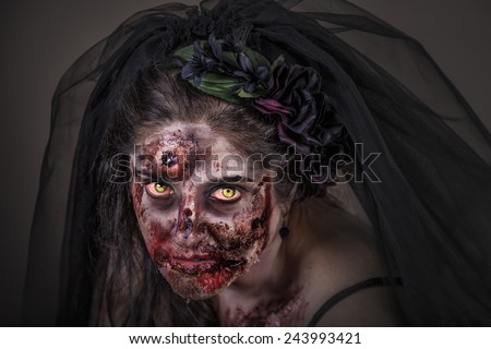 is a zombie dressed in a wedding dress - stock photo