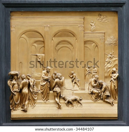 """Isaac with Esau and Jacob by Ghiberti. Detail of the panel on the doors (""""Gates of Paradise"""") of the Duomo Baptistry, Florence, Italy. - stock photo"""