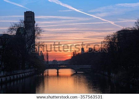 Isar river and famous deutsches museum at sunset in the old town of munich. - stock photo