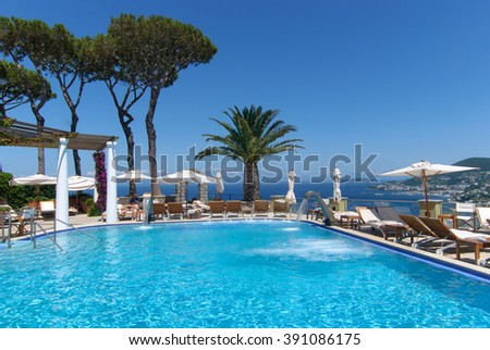 ISCHIA, ITALY - June 23, 2013: Beautiful view from a luxury hotel San Montano on  the thermal pool and island. - stock photo