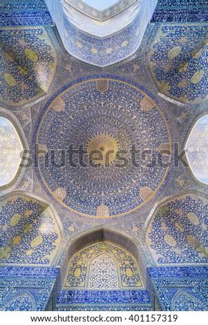Isfahan, Iran - December 13, 2015: The Shah Mosque  at Naqhsh-e Jahan Square in Isfahan, Iran. Ceiling view  - stock photo