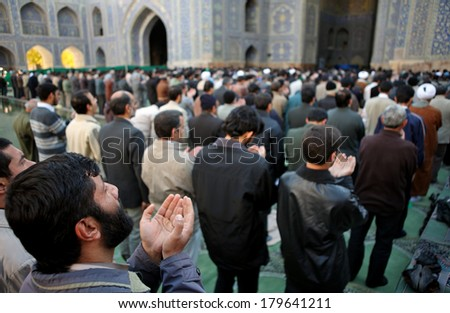 ISFAHAN, IRAN - NOVEMBER 30, 2007: Muslim Friday mass prayer in Imam Mosque (Jameh Abbasi Mosque) - stock photo