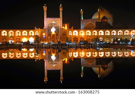 ISFAHAN, IRAN - OCTOBER 13: Imam Mosque on October 13, 2013 in Isfahan, Iran. Imam Mosque is standing in south side of Imam Square and regarded as one of the masterpieces of Persian architecture. - stock photo