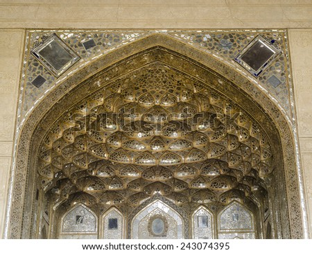 ISFAHAN, IRAN  OCTOBER 23: Muqarnas vault decorated with Venetian glass in Chehel Sotoun palace on October 23, 2014 in Isfahan. Chehel sotoun was built in 1646 by Shah Abbas II . - stock photo