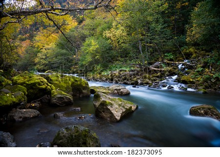 Ishikari river and waterfall in Sounkyo,Hokkaido, with autumn scene - stock photo