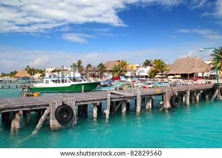 Isla Mujeres island dock port pier colorful Mexico Cancun - stock photo