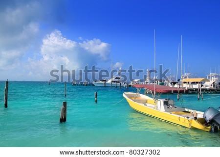 Isla Mujeres Mexico boats turquoise anchored in Caribbean sea from Quintana Roo - stock photo