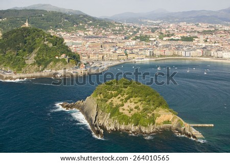 Isla Santa Clara Island in Bahia de La Concha, Donostia-San Sebastian, Basque region of Spain, the Queen of Euskadi's and Cantabrian Coast, as seen from Monte Igueldo overlook view spot - stock photo