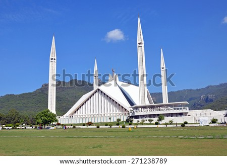 ISLAMABAD - APRIL 2 2015: Shah Faisal Mosque was completed in 1986 and was the largest mosque in the world until 1993.It is shaped like a desert Bedouin's tent. - stock photo