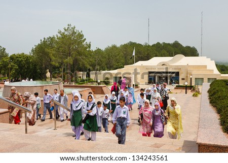 ISLAMABAD - JULY 16: Schoolchildren visit the Pakistan Monument on July 16, 2011 in Islamabad. The monument represents Pakistan's progress as a developing country, its provinces and its territories. - stock photo