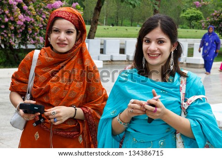 ISLAMABAD - JULY 16: Two unidentified Pakistani tourists on July 16, 2011 in Islamabad. Despite security concerns and mismanagement, the tourism industry is a growing economic factor in Pakistan. - stock photo