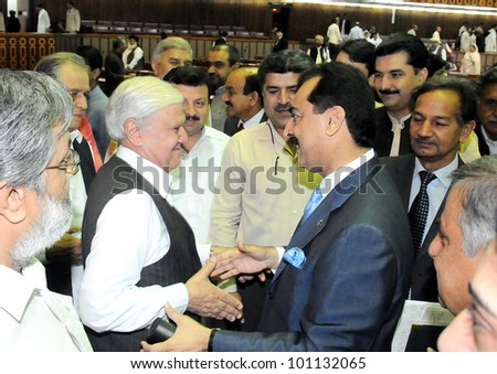 ISLAMABAD, PAKISTAN - APR 27: Members of Parliament greet to the Prime Minister, Syed Yousuf Raza Gilani during National Assembly Session held at Parliament House on April 27, 2012 in Islamabad.