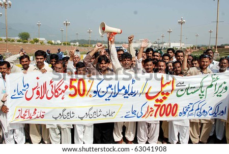 ISLAMABAD, PAKISTAN - OCT 14: Employees of Radio Pakistan protest in favor of their demands during demonstration at Parliament House on October 14, 2010 in Islamabad. - stock photo