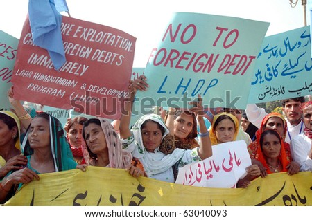ISLAMABAD, PAKISTAN - OCT 14: Supporters of Sindh Bachao Tehreek protest in favor of their demands during a demonstration on October 14, 2010 in Islamabad. - stock photo