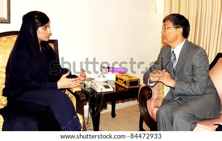 ISLAMABAD, PAKISTAN - SEPT 11: Federal Minister for Foreign Affairs, Hina Rabbani Khar talks with China Ambassador, Liu Jian during meeting in Islamabad on Sunday, September 11,2011