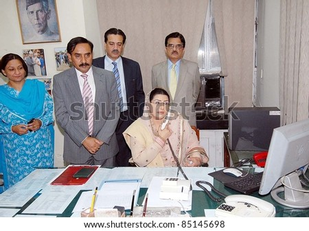 ISLAMABAD, PAKISTAN - SEPT 21: Federal Minister for Information and Broadcasting, Dr.Firdous Ashiq Awan receives call after inauguration of Crisis Communication on September 21, 2011in Islamabad .