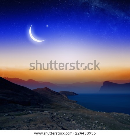 Islamic background with moon and stars, holy month, Ramadan Kareem, mountain silhouettes. Elements of this image furnished by NASA - stock photo