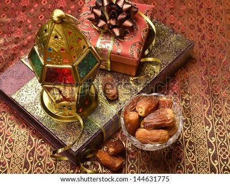 Islamic lamp and gifts - stock photo